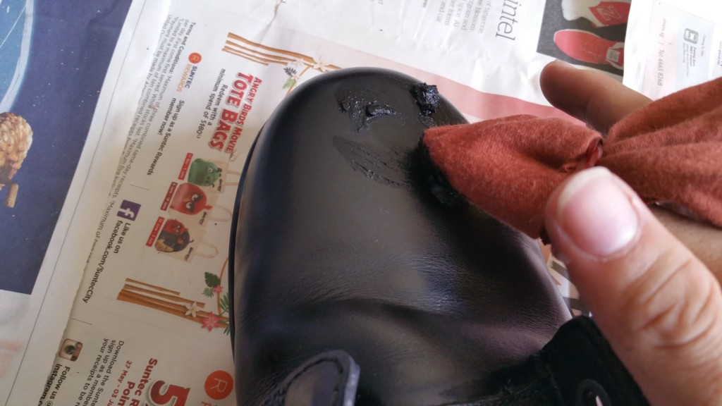 apply liberal amount of wax polish on boot